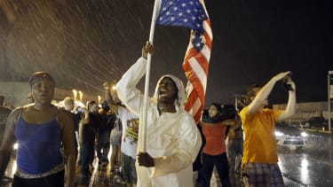 Protesters mark the one-year anniversary of Michael Brown's death.