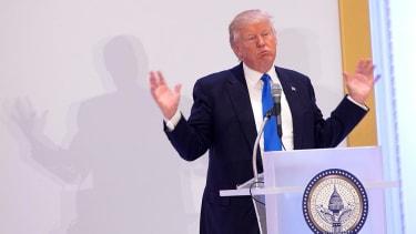 Donald Trump hands over his smartphone