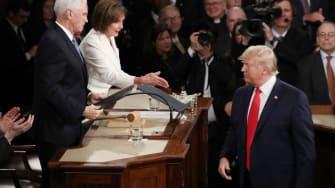 Nancy Pelosi reaches out to shake Trump's hand.