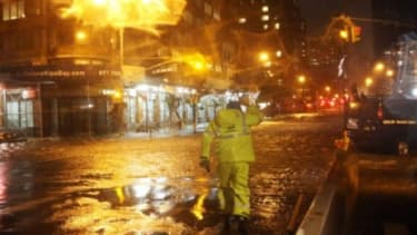 A Con Edison worker walks through the flood waters in front of NYU Langone Medical Center in midtown Manhattan during Hurricane Sandy on Oct. 29.