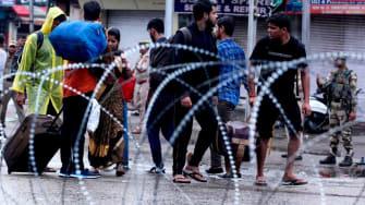 India places Kashmir under lockdown