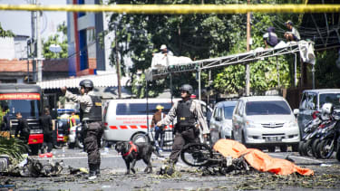 K9 police examine a site following attacks outside the Surabaya Centre Pentecostal Church (Surabaya Gereja Pantekosta Pusat) in Surabaya, East Java on May 13, 2018.