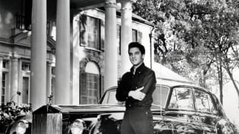 Elvis outside of his Graceland home.