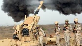 Saudi Arabian soldiers fire shells toward Yemen.
