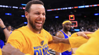 Steph Curry celebrates the Golden State Warrior win over Spurs