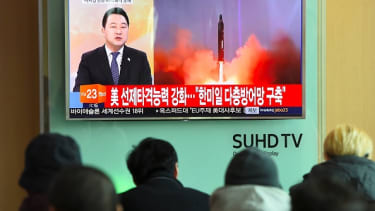 People watch news coverage of a North Korean missile launch.
