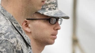 Bradley Manning (right) is escorted to the courthouse Sunday for the third day of his hearing: The alleged WikiLeaker was incarcerated for 18 months before getting his day in court.