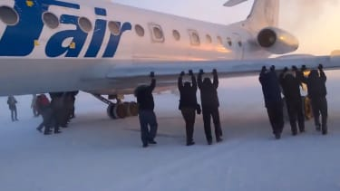 Passengers take plane trouble into their own hands, push plane themselves