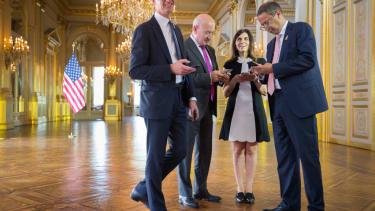 Diplomats read their phones