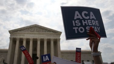 Someone hoists an ObamaCare sign in Washington