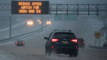 A car driving in dangerous winter weather