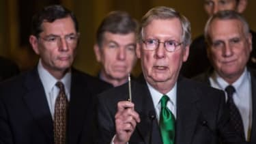 Senate Minority Leader Mitch McConnell and fellow Republicans at a Dec. 4 news conference.