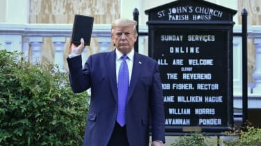 Donald Trump holds a Bible.