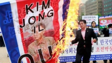 South Koreans protest the North Korean missile attack.