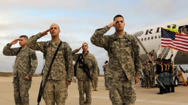 Troops salute after they arrive at their home base of Fort Hood, after being part of one of the last American combat units to exit from Iraq on December 16, 2011.