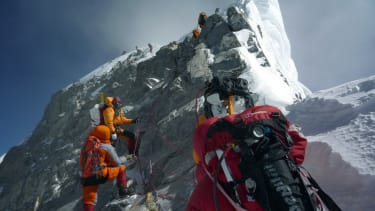 Climbers go up Mount Everest.