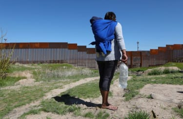 A migrant and their child at the U.S.-Mexico border.