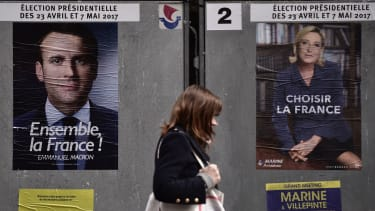 Posters for French presidential candidates Emmanuel Macron and Marine Le Pen.