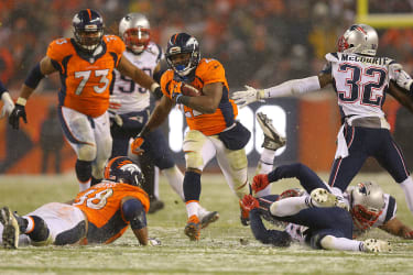 C.J. Anderson of the Denver Broncos runs in the winning touchdown versus the New England Patriots