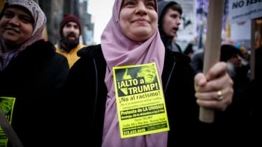 A Muslim woman protests outside Trump Tower.