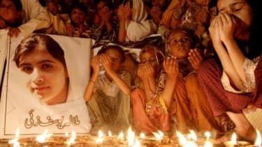 A group of Pakistani children pray for Malala Yousufzai (the 14-year-old girl who was shot by the Taliban) in Karachi, on Oct.12.