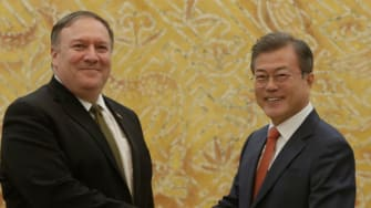 Secretary of State Mike Pompeo shakes hands with South Korean President Moon Jae-in