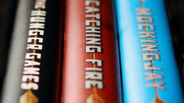 """Complaints about """"The Hunger Games"""" books' objectionable content and their place in school libraries have only increased since the popular movie's release."""