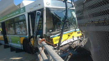 Bus dangles over highway after smashing through guardrail outside Boston