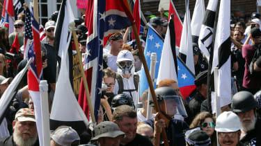 White nationalist demonstrators walk into Lee Park in Charlottesville, Virginia.