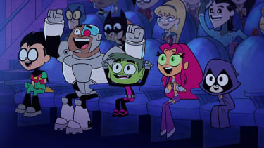 Robin, Cyborg, Beast Boy, Starfire, and Raven sit at a movie theater in the new Teen Titans Go movie