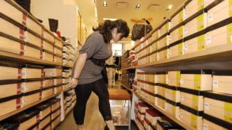 A woman tries shoes on at a Payless in Manhattan.