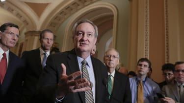 Sen. Mike Crapo joins Republicans to back a financial deregulation bill.