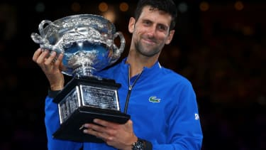 Novak Djokovic of Serbia poses with the Norman Brookes Challenge Cup following victory in his Men's Singles Final match against Rafael Nadal of Spain during day 14 of the 2019 Australian Open