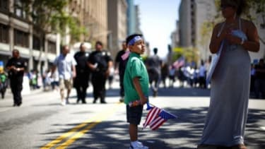 A young demonstrator marches during an immigration reform protest on May 1: Alabama is close to passing an immigration law that's tougher than Arizona's.