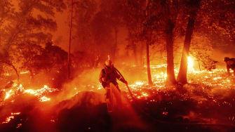 A California firefighter battles a blaze.