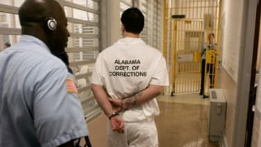 A man, convicted of murder when he was 16, is escorted through maximum security: The Supreme Court confronts whether convicting teens to a life in prison is cruel and unusual punishment.