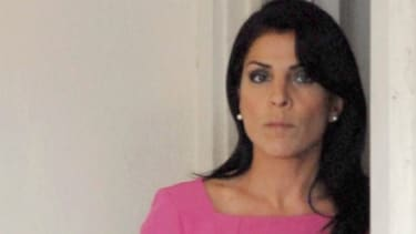 Jill Kelley leaves her home on Nov. 13: Kelley and her husband, a doctor, apparently bankrupted their cancer charity after less than a year.