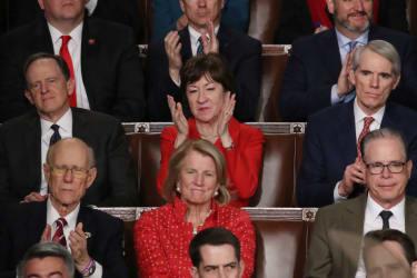 Susan Collins claps