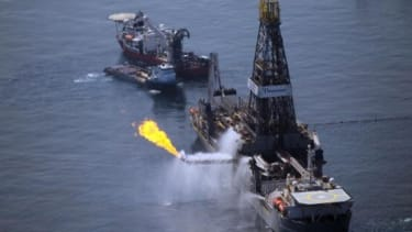 A flare burns from a ship recovering oil from the BP oil spill.