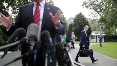 Stephen Miller walks away