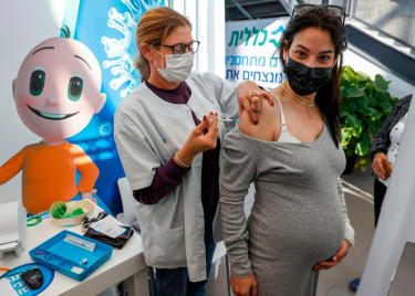 Pregnant woman gets vaccinated in Israel