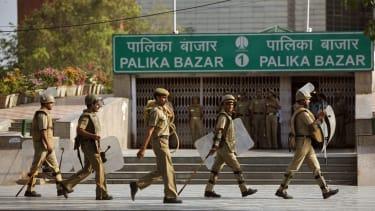 Riot policemen perform a mock drill in New Delhi, India, in 2009.