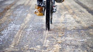 A person rides a bike.