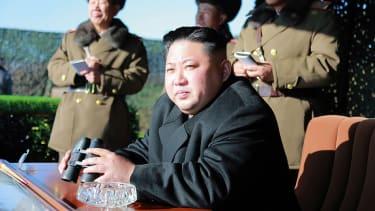 North Korean leader Kim Jong Un watches a military drill
