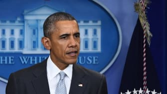 President Barack Obama addresses the press following a series of attacks in Paris on November 13.