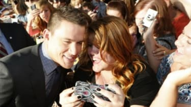 Channing Tatum poses for a picture with a female fan at the Magic Mike premiere: 73 percent of the film's opening-weekend audience was composed of women.
