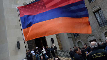 U.S. and Armenian flags.