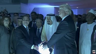Trump, Saudi King Salman, and Egypt's president touch a glowing orb