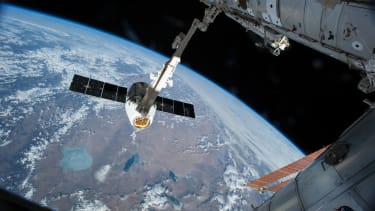 SpaceX Dragon cargo spacecraft attaches to the International Space Station.