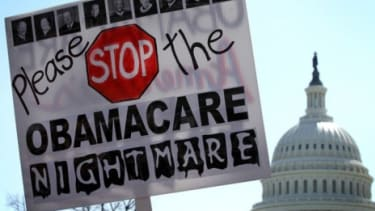 Tea Party supporters protest outside the Supreme Court where justices Wednesday will consider if President Obama's health care can survive without the individual mandate.